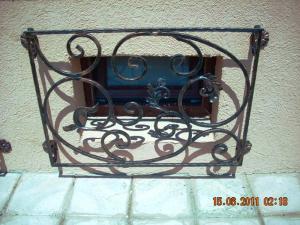 Grilaj fier forjat pentru geamuri Poderale Company