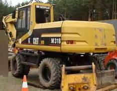 Excavator Caterpillar M 318 de vanzare second hand vanzari excavatoare