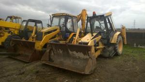 Motor buldoexcavator caterpillar 428