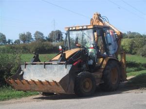 Inchiriere buldoexcavator caterpillar